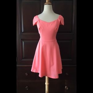 Bright pink cap sleeve dress with open back